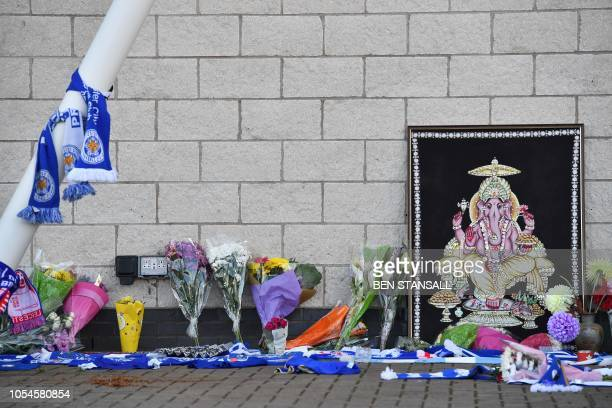 Leicester City scarfs are seen tied to a support next to floral tributes outside Leicester City Football Club's King Power Stadium in Leicester...