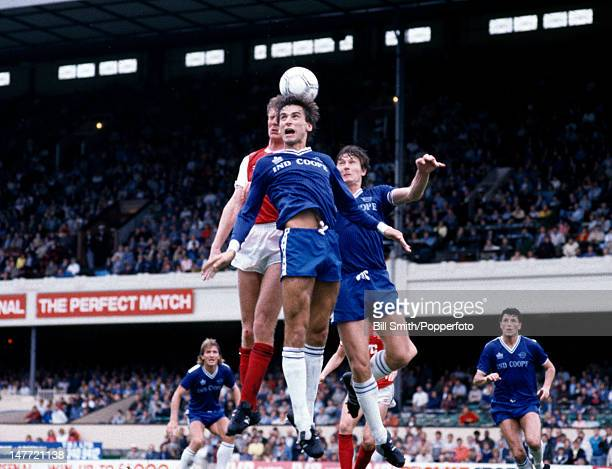Leicester City striker Alan Smith challenging for a high ball with Arsenal defender Tommy Caton during their First Division match at Highbury Stadium...