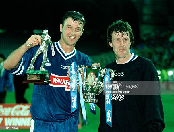 Leicester City striker Steve Claridge and man of the match Steve Walsh celebrate with the trophy after the Coca Cola League Cup Final Replay between...