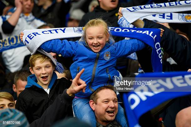 Leicester City supporters celebrate their team's win after the Barclays Premier League match between Crystal Palace and Leicester City at Selhurst...