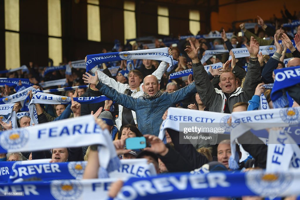 Leicester City supporters celebrate their team's win after the Barclays Premier League match between Crystal Palace and Leicester City at Selhurst Park on March 19, 2016 in London, United Kingdom.