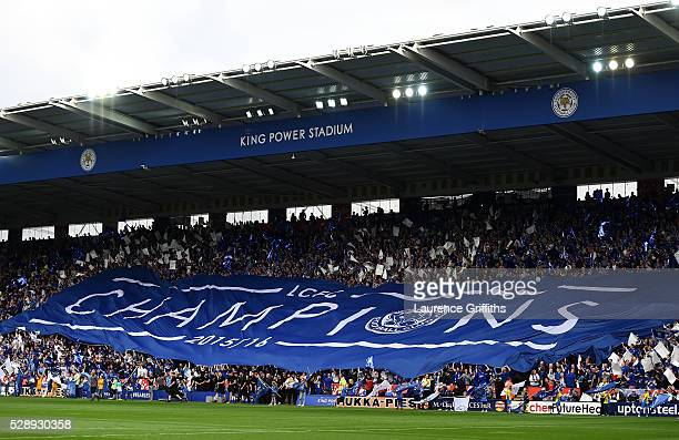 Leicester City supporters hold a big Champions banner prior to the Barclays Premier League match between Leicester City and Everton at The King Power...