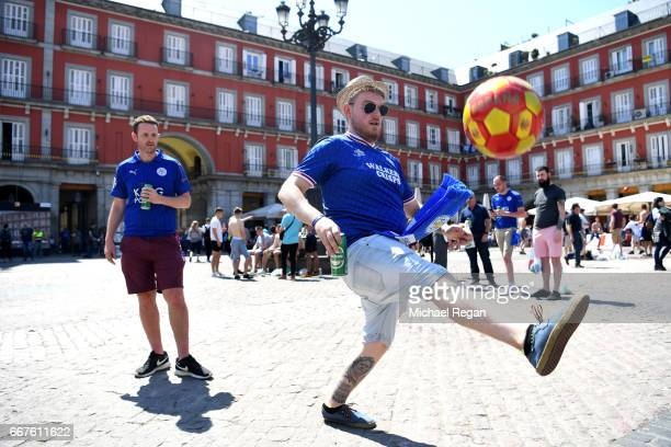 Leicester City supporters play football in the Plaza Mayor Square prior to the UEFA Champions League Quarter Final first leg match between Club...