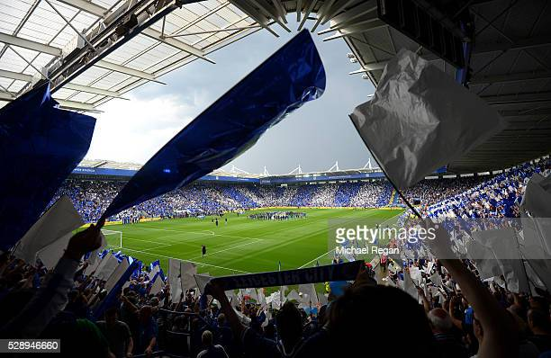 Leicester City supporters wave flags in celebration of the season champions after the Barclays Premier League match between Leicester City and...