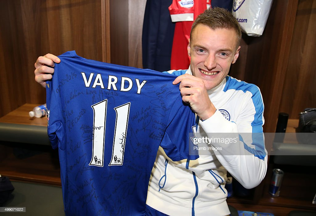 Leicester City vice chairman Aiyawatt Srivaddhanaprabha presents Jamie Vardy of Leicester City with a shirt to commemorate him scoring in his 11th consecutive premier league game after the Barclays Premier League match between Leicester City and Manchester United at the King Power Stadium on November 28th , 2015 in Leicester, United Kingdom.