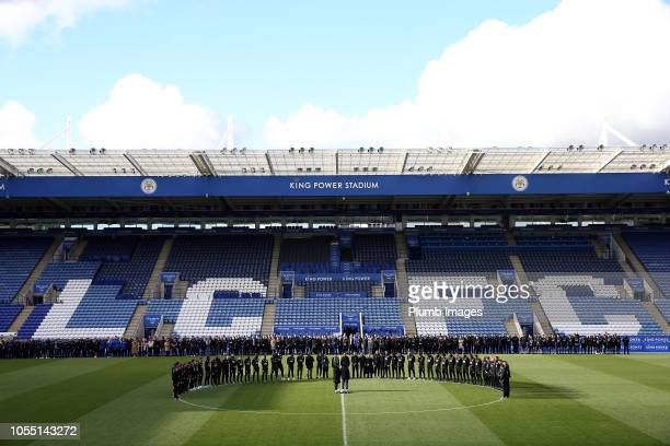 Leicester City vice chairman Aiyawatt Top Srivaddhanaprabha and mother Aimon Srivaddhanaprabha lay a wreath during a minute's silence held by...