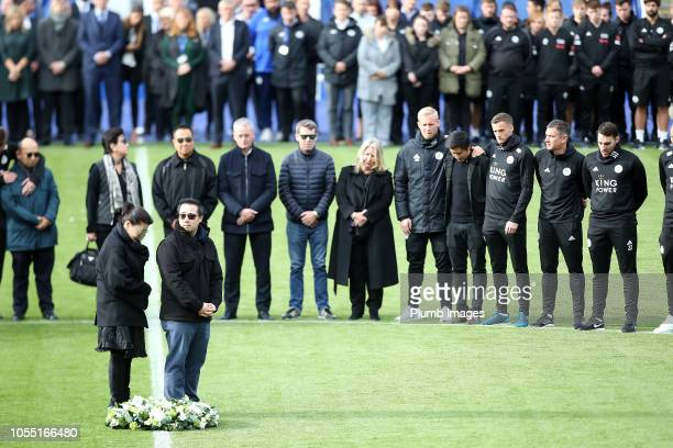 Leicester City vice chairman Aiyawatt 'Top' Srivaddhanaprabha and mother Aimon Srivaddhanaprabha lay a wreath during a minute's silence held by...