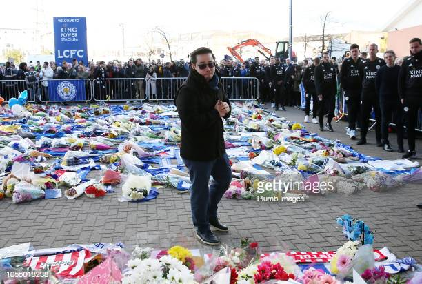Leicester City vice chairman Aiyawatt 'Top' Srivaddhanaprabha and first team visits the tributes at King Power Stadium to his late father owner...
