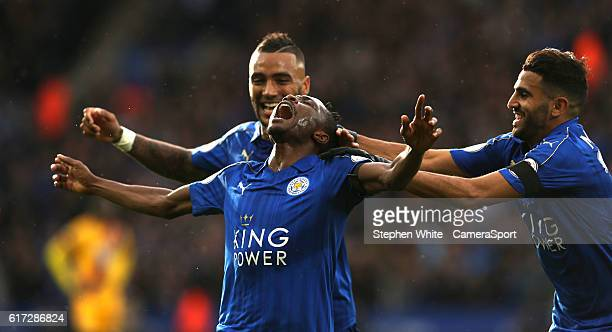 Leicester City's Ahmed Musa celebrates scoring the opening goal with teammates Danny Simpson and Riyad Mahrez during the Premier League match between...