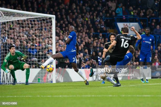 Leicester City's Aleksandar Dragovic sees his shot blocked during the Premier League match between Chelsea and Leicester City at Stamford Bridge on...