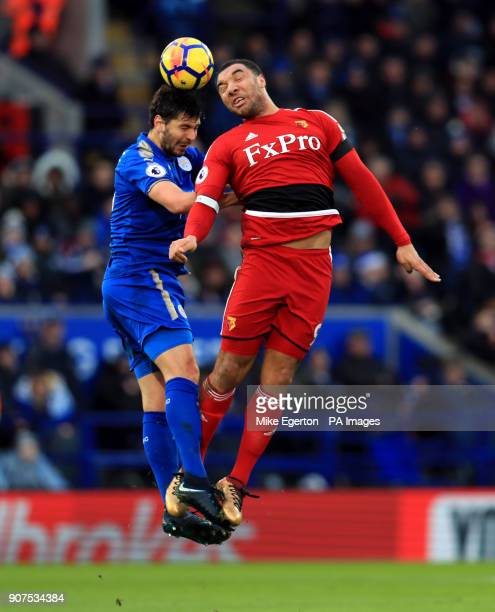 Leicester City's Aleksander Dragovic and Watford's Troy Deeney battle for the ball in the air during the Premier League match at the King Power...