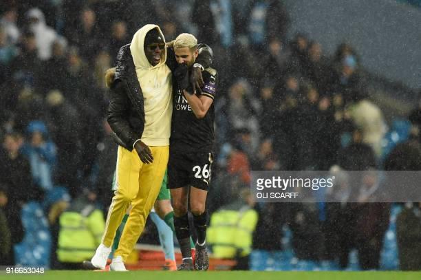 Leicester City's Algerian midfielder Riyad Mahrez and Leicester City's French midfielder Nampalys Mendy gesture after the English Premier League...