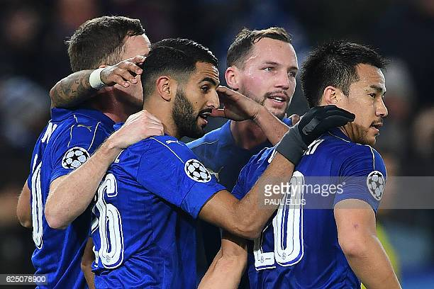 Leicester City's Algerian midfielder Riyad Mahrez celebrates scoring his team's second goal from the penalty spot with Leicester City's English...