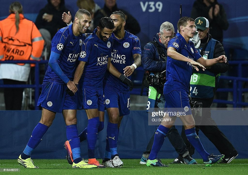 Leicester City's Algerian midfielder Riyad Mahrez (2L) celebrates with Leicester City's Algerian striker Islam Slimani (L) after scoring his team's first goal during the UEFA Champions League group G football match between Leicester City and FC Copenhagen at the King Power Stadium in Leicester, central England on October 18, 2016. / AFP / OLI