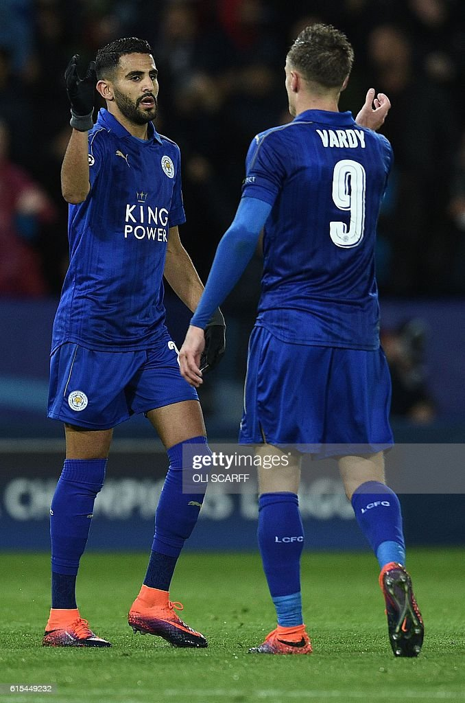 Leicester City's Algerian midfielder Riyad Mahrez (L) celebrates with Leicester City's English striker Jamie Vardy after scoring his team's first goal during the UEFA Champions League group G football match between Leicester City and FC Copenhagen at the King Power Stadium in Leicester, central England on October 18, 2016. / AFP / OLI