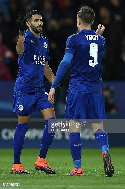Leicester City's Algerian midfielder Riyad Mahrez celebrates with Leicester City's English striker Jamie Vardy after scoring his team's first goal...
