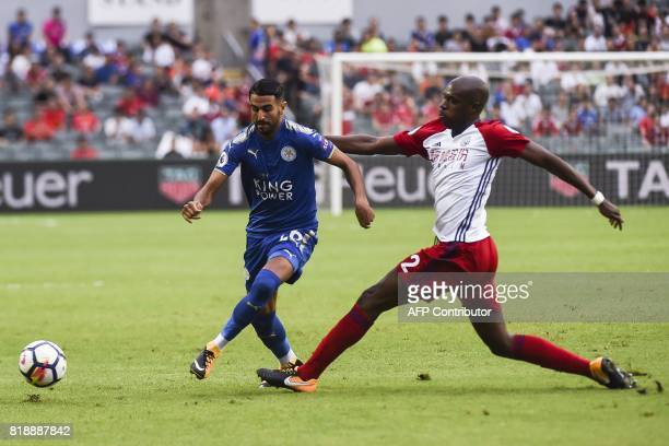 Leicester City's Algerian midfielder Riyad Mahrez challenges West Bromwich Albion's Cameroonian defender Allan Nyom during the 2017 Premier League...