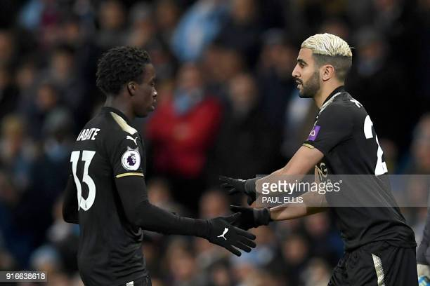 Leicester City's Algerian midfielder Riyad Mahrez comes in place of Leicester City's Malian midfielder Fousseni Diabate during the English Premier...