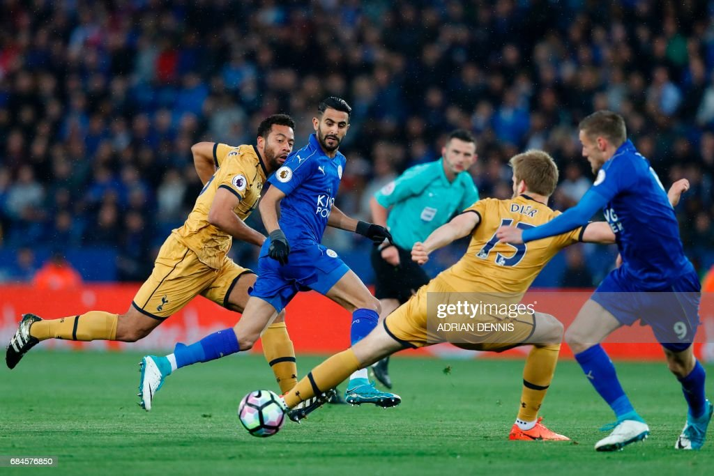 TOPSHOT - Leicester City's Algerian midfielder Riyad Mahrez (2nd L) passes the ball to Leicester City's English striker Jamie Vardy (R) as he runs through the Tottenham defence during the English Premier League football match between Leicester City and Tottenham Hotspur at King Power Stadium in Leicester, central England on May 18, 2017. / AFP PHOTO / Adrian DENNIS / RESTRICTED TO EDITORIAL USE. No use with unauthorized audio, video, data, fixture lists, club/league logos or 'live' services. Online in-match use limited to 75 images, no video emulation. No use in betting, games or single club/league/player publications. /
