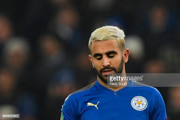 Leicester City's Algerian midfielder Riyad Mahrez reacts after having his penalty saved in the penalty shoot out after extra time in the English...