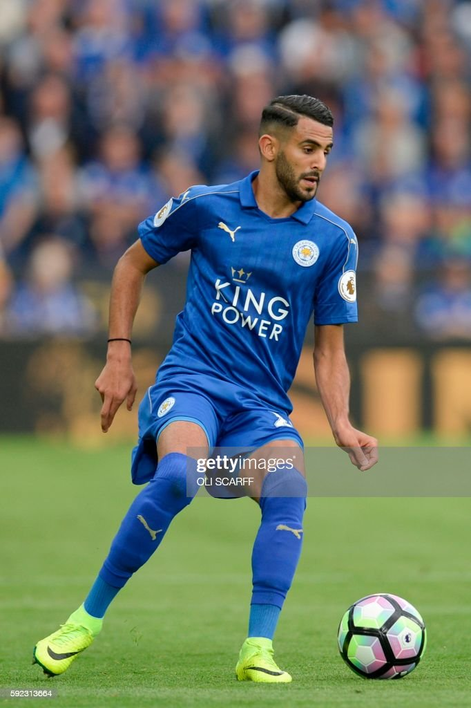 Leicester City's Algerian midfielder Riyad Mahrez runs with the ball during the English Premier League football match between Leicester City and Arsenal at King Power Stadium in Leicester, central England on August 20, 2016. / AFP PHOTO / OLI SCARFF / RESTRICTED TO EDITORIAL USE. No use with unauthorized audio, video, data, fixture lists, club/league logos or 'live' services. Online in-match use limited to 75 images, no video emulation. No use in betting, games or single club/league/player publications. /
