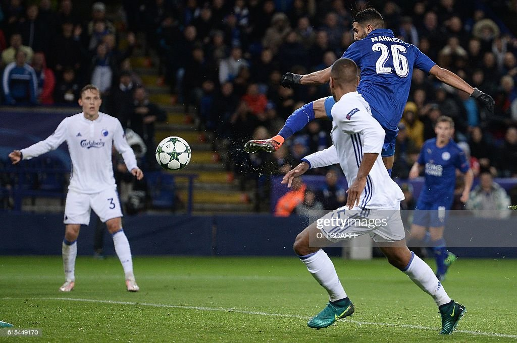 TOPSHOT - Leicester City's Algerian midfielder Riyad Mahrez scores his team's first goal during the UEFA Champions League group G football match between Leicester City and FC Copenhagen at the King Power Stadium in Leicester, central England on October 18, 2016. / AFP / OLI
