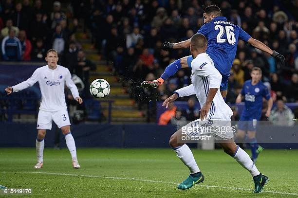 TOPSHOT Leicester City's Algerian midfielder Riyad Mahrez scores his team's first goal during the UEFA Champions League group G football match...