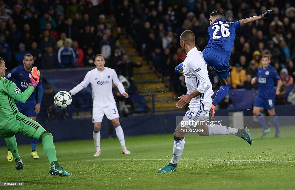 Leicester City's Algerian midfielder Riyad Mahrez scores his team's first goal during the UEFA Champions League group G football match between Leicester City and FC Copenhagen at the King Power Stadium in Leicester, central England on October 18, 2016. / AFP / OLI