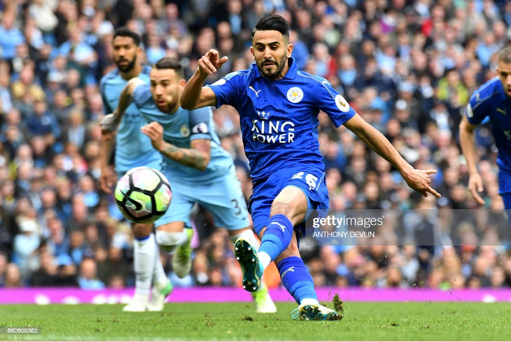 Leicester City's Algerian midfielder Riyad Mahrez takes his penalty, which hit his standing foot on the way to the goal, and was subsequently disallowed during the English Premier League football match between Manchester City and Leicester City at the Etihad Stadium in Manchester, north west England, on May 13, 2017. / AFP PHOTO / Anthony DEVLIN / RESTRICTED TO EDITORIAL USE. No use with unauthorized audio, video, data, fixture lists, club/league logos or 'live' services. Online in-match use limited to 75 images, no video emulation. No use in betting, games or single club/league/player publications. /
