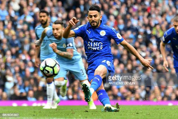 Leicester City's Algerian midfielder Riyad Mahrez takes his penalty which hit his standing foot on the way to the goal and was subsequently...