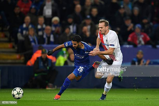 Leicester City's Algerian midfielder Riyad Mahrez vies against Club Brugge's Belgian defender Laurens De Bock during the UEFA Champions League group...