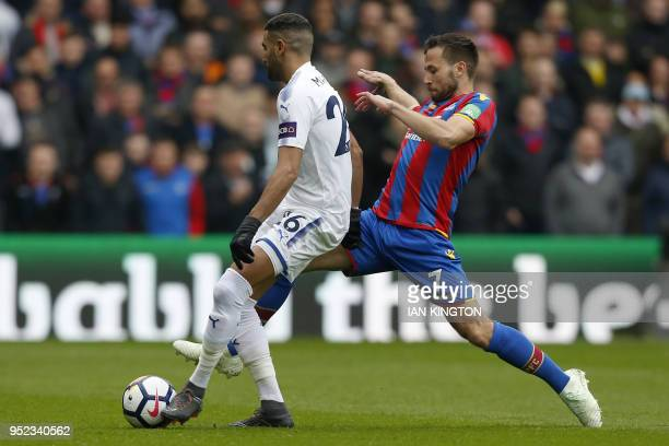 Leicester City's Algerian midfielder Riyad Mahrez vies with Crystal Palace's French midfielder Yohan Cabaye during the English Premier League...