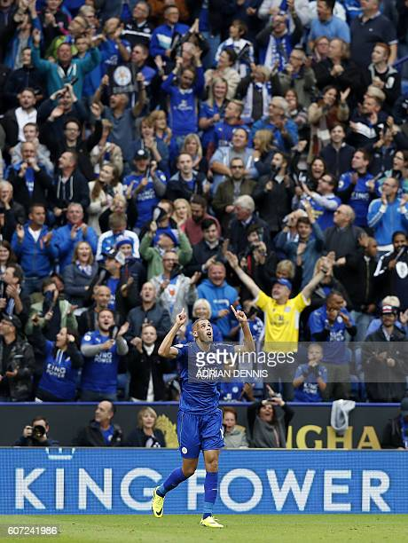 Leicester City's Algerian striker Islam Slimani celebrates after scoring during the English Premier League football match between Leicester City and...
