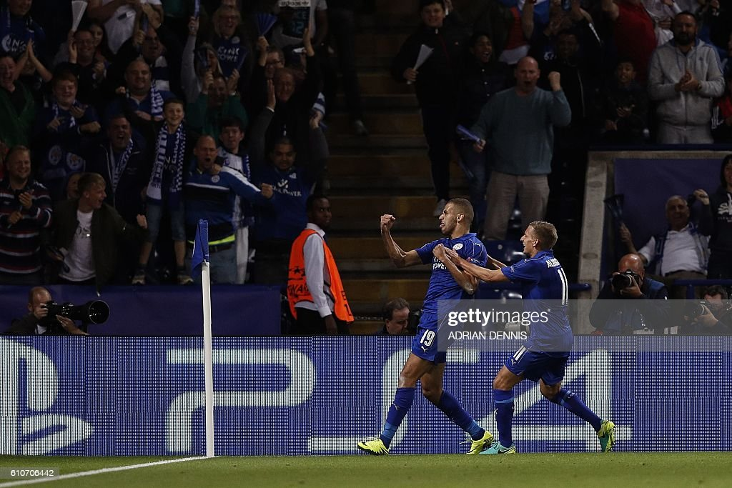Leicester City's Algerian striker Islam Slimani (C) celebrates scoring his team's first goal during the UEFA Champions League group G football match between Leicester City and Porto at the King Power Stadium in Leicester, central England on Septmeber 27, 2016. / AFP / Adrian DENNIS