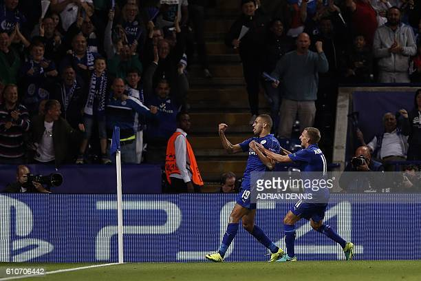 Leicester City's Algerian striker Islam Slimani celebrates scoring his team's first goal during the UEFA Champions League group G football match...
