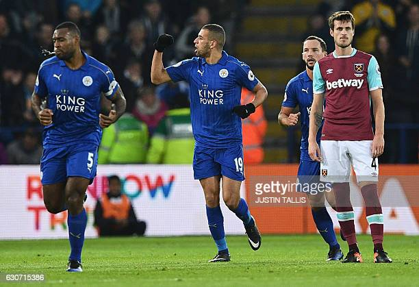 Leicester City's Algerian striker Islam Slimani celebrates scoring his team's first goal during the English Premier League football match between...