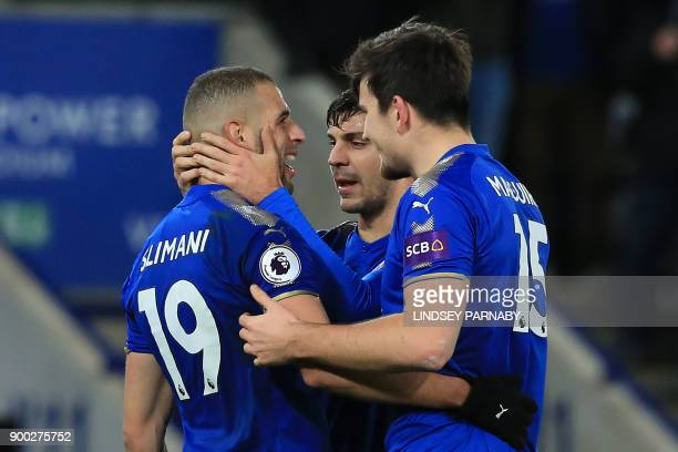 Leicester City's Algerian striker Islam Slimani celebrates scoring the team's second goal with teammates during the English Premier League football...