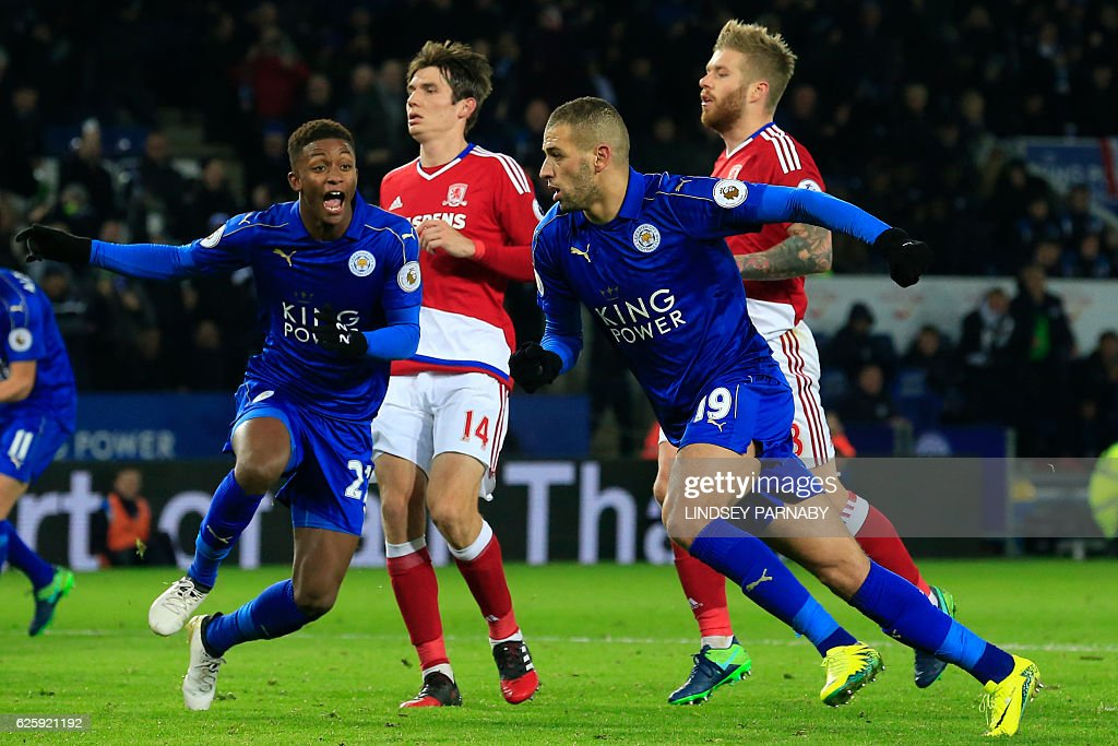 Leicester City's Algerian striker Islam Slimani (2nd R) celebrates with Leicester City's English midfielder Demarai Gray (L) after scoring Leicester's late goal from the penalty spot during the English Premier League football match between Leicester City and Middlesbrough at King Power Stadium in Leicester, central England on November 26, 2016. The game finished 2-2. / AFP / Lindsey PARNABY / RESTRICTED TO EDITORIAL USE. No use with unauthorized audio, video, data, fixture lists, club/league logos or 'live' services. Online in-match use limited to 75 images, no video emulation. No use in betting, games or single club/league/player publications. /