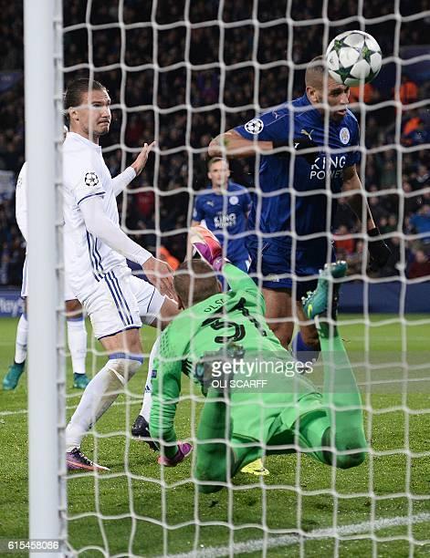Leicester City's Algerian striker Islam Slimani heads the ball to score past FC Copenhagen's Swedish goalkeeper Robin Olsen but the goal is...