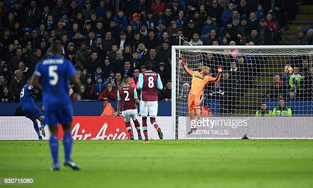 Leicester City's Algerian striker Islam Slimani scores his team's first goal past West Ham United's Irish goalkeeper Darren Randolph during the...