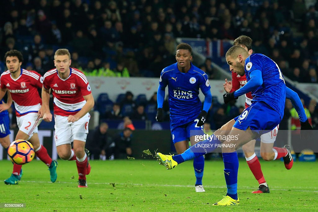 Leicester City's Algerian striker Islam Slimani (R) scores Leicester's late goal from the penalty spot during the English Premier League football match between Leicester City and Middlesbrough at King Power Stadium in Leicester, central England on November 26, 2016. The game finished 2-2. / AFP / Lindsey PARNABY / RESTRICTED TO EDITORIAL USE. No use with unauthorized audio, video, data, fixture lists, club/league logos or 'live' services. Online in-match use limited to 75 images, no video emulation. No use in betting, games or single club/league/player publications. /
