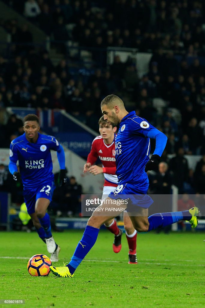 Leicester City's Algerian striker Islam Slimani scores Leicester's late goal from the penalty spot during the English Premier League football match between Leicester City and Middlesbrough at King Power Stadium in Leicester, central England on November 26, 2016. The game finished 2-2. / AFP / Lindsey PARNABY / RESTRICTED TO EDITORIAL USE. No use with unauthorized audio, video, data, fixture lists, club/league logos or 'live' services. Online in-match use limited to 75 images, no video emulation. No use in betting, games or single club/league/player publications. /