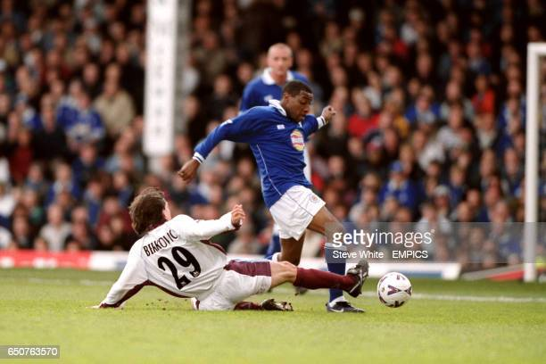 Leicester City's Andrew Impey chases down the ball whilst being blocked by West Ham United's Eyal Berkovic