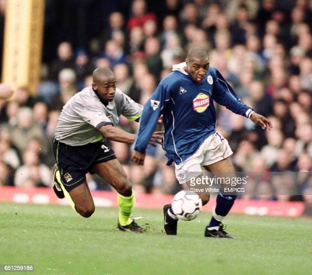 Leicester City's Andy Impey gets away from a challenge from Manchester City's Paulo Wanchope