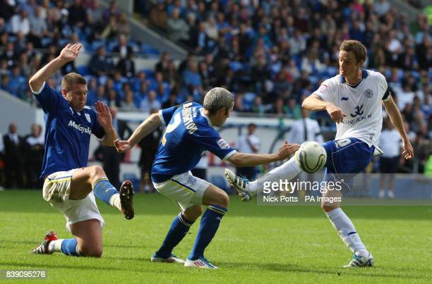 Leicester City's Andy King's shot at goal is blocked by Cardiff City defender Anthony Gerrard and Kevin McNaughton during the npower Football League...