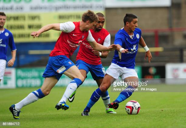 Leicester City's Anthony Knockaert in action with York City's Daniel Parslow and Ashley Chambers during the preseason friendly at Bootham Crescent...