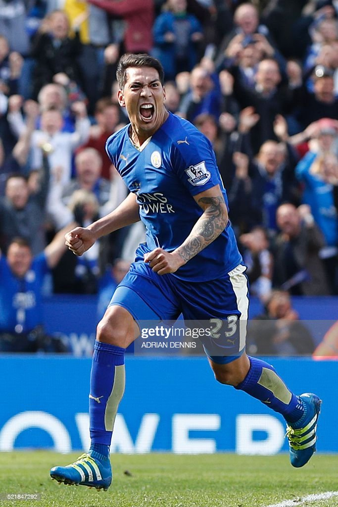 Leicester City's Argentinian striker Leonardo Ulloa celebrates after scoring their second goal from the penalty spot to equalise 2-2 as West Ham United's Spanish goalkeeper Adrian (R) reacts during the English Premier League football match between Leicester City and West Ham United at King Power Stadium in Leicester, central England on April 17, 2016. / AFP / ADRIAN DENNIS / RESTRICTED TO EDITORIAL USE. No use with unauthorized audio, video, data, fixture lists, club/league logos or 'live' services. Online in-match use limited to 75 images, no video emulation. No use in betting, games or single club/league/player publications. /