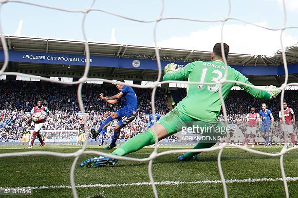 Leicester City's Argentinian striker Leonardo Ulloa scores their second goal from the penalty spot to equalise 22 as West Ham United's Spanish...