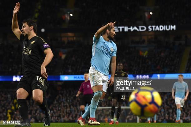 Leicester City's Austrian defender Aleksandar Dragovic and Manchester City's German midfielder Ilkay Gundogan gesture during the English Premier...
