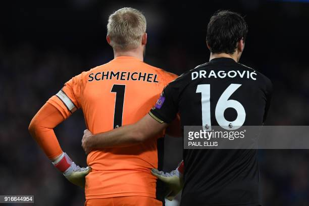 Leicester City's Austrian defender Aleksandar Dragovic consoles Leicester City's Danish goalkeeper Kasper Schmeichel after his mistake leads to...